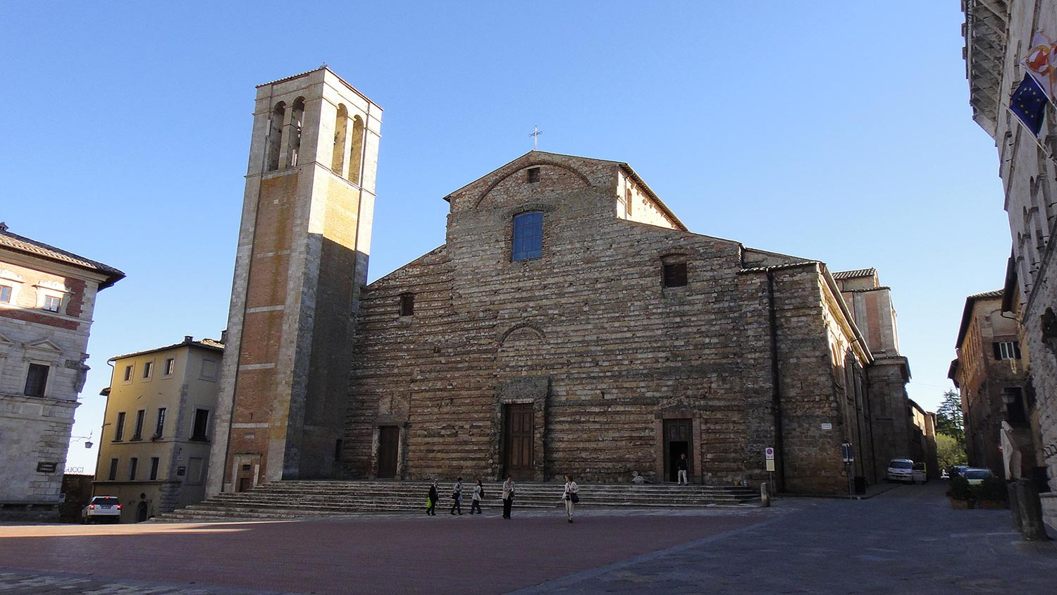 Which churches should be visited in Montepulciano?